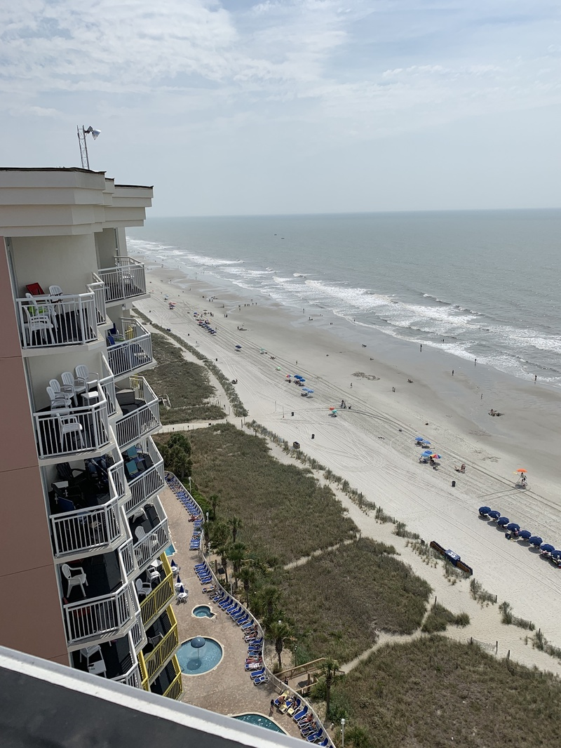 Miles of white sand beach right outside of your condo
